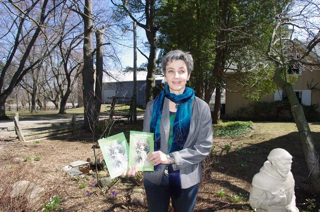 Robyn Marie Butt, in the garden of her 11th Line home, recently released her second volume in the series A Hundred Poems about Flowers. (HEATHER RIVERS/WOODSTOCK SENTINEL-REVIEW)