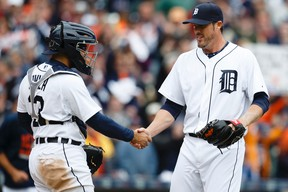 Detroit Tigers closer Joe Nathan (right) and catcher Alex Avila celebrate after a win over the Minnesota Twins at Comerica Park. (Rick Osentoski/USA TODAY Sports)