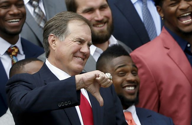 New England Patriots head coach Bill Belichick gives a thumbs down to a joke about deflated balls by U.S. President Barack Obama during a reception for the Super Bowl champion New England Patriots at the White House in Washington April 23, 2015. (REUTERS/Jonathan Ernst)