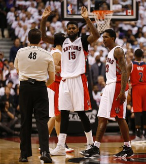 Toronto Raptors' Amir Johnson (15) and Lou Williams argue with referee Scott Foster in Game 2 against the Washington Wizards. (Jack Boland/Toronto Sun/Postmedia Network)