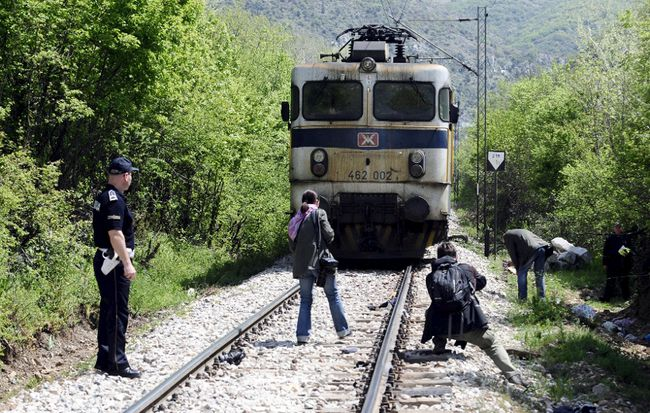Media and police inspect at the scene where fourteen migrants were hit by a train, near Veles  April 24, 2015. Fourteen migrants were hit by a train and killed in central Macedonia late on Thursday as they walked through a canyon along an increasingly well-trodden Balkan route for migrants trying to reach western Europe.The accident happened at around 10.30 p.m. (2030 GMT) near the central city of Veles. Rescue efforts were hampered by difficult terrain, with the site of the accident accessible only by foot or railway.  REUTERS/Ognen Teofilovski