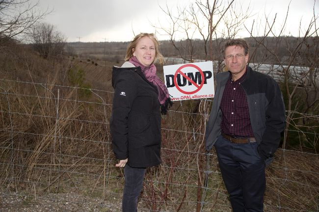 Natalie Minato and Steve McSwiggan at the proposed site of a garbage dump in Ingersoll. (DEREK RUTTAN, The London Free Press)