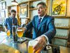Finance Minister Charles Sousa during a beer pouring photo-op after speaking Bellwoods Brewery about the budget plan on Friday, April 24, 2015. (ERNEST DOROSZUK/Toronto Sun)