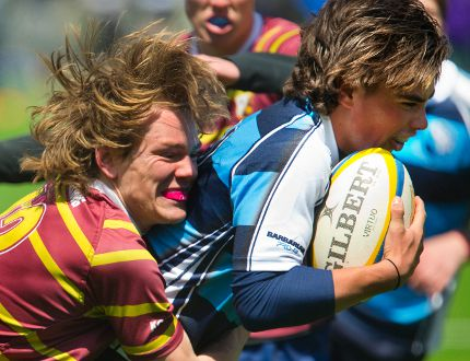 Banting's Adam Redgrift attempts to stop Lucas' Adam Cox from getting his third try of the first half of the their pre-season rugby game. Lucas won 26-7 over Banting. (Mike Hensen/The London Free Press)