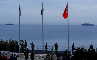 Australian, New Zealand and Turkish soldiers attend a dawn ceremony marking the 100th anniversary of the Battle of Gallipoli, at Anzac Cove in Gallipoli April 25, 2015. The battle on Turkey's Gallipoli peninsula was one of the bloodiest of the Great War, as thousands of soldiers from the Australian and New Zealand Army Corps (ANZAC) were cut down by machinegun and artillery fire as they struggled ashore on a narrow beach. The fighting would eventually claim more than 130,000 lives, 87,000 of them on the Ottoman side, before the Turks finally repulsed the poorly planned Allied campaign. REUTERS/Osman Orsal