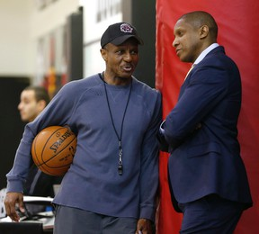 Raptors coach Dwane Casey and GM Masai Ujiri chat.prior to the start of their first-round playoff series against the Wizards. (JACK BOLAND/TORONTO SUN)