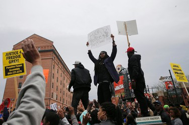 """Protesters gather for a rally to protest the death of Freddie Gray who died following an arrest in Baltimore, Maryland April 25, 2015. More than 1,000 demonstrators chanting """"shut it down"""" marched through Baltimore on Saturday to protest the death of a black man who died after being taken into police custody. REUTERS/Shannon Stapleton"""