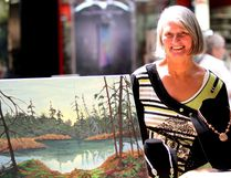 Artist Jeanne Dumas speaks with browsers Saturday at Station Mall during Algoma Art Society's spring show and sale. Dumas was one of six artists who took part in the day-long event featuring original work, prints, cards and jewelry.