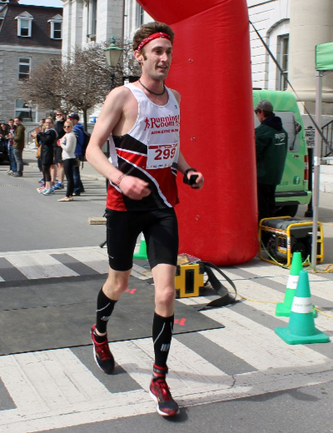 Kevin Coffey of Kingston, after winning the Limestone Race Weekend half-marathon in Kingston, Ont. on Sunday April 26, 2015. Steph Crosier/Kingston Whig-Standard/Postmedia Network