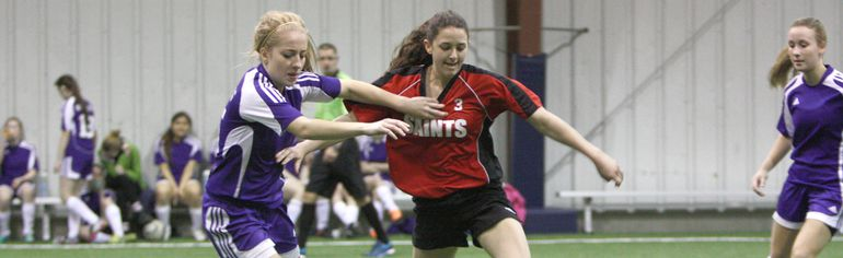 Beaver Brae's Spencer Alcock and Mica Davidson-Hunt of St. Thomas Aquinas battle for the ball in Friday morning's opening round-robin game of the 2015 Bronco Girls Soccer Tournament.  LLOYD MACK/Daily Miner and News