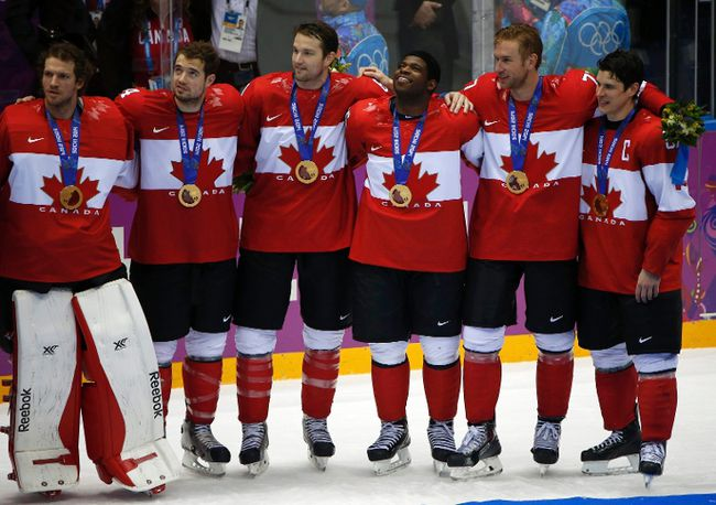 Canada's Sidney Crosby (R), Jeff Carter (2nd from R), P.K. Subban, (3rd from R) , goalie Mike Smith (L), Chris Kunitz (2nd from L) and Drew Doughty