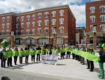 Members of the local chapter of the Kidney Foundation of Canada, along with supporters and transplant recipients, stand in Harmony Square on Sunday to promote the Living Green Ribbon of Hope. (Michael-Allan Marion / The Expositor)