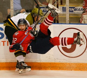 Generals' Anthony Cirelli is taken down by Austin Kosack of the North Bay Battalion during Game 2 on Sunday night in Oshawa. (STAN BEHAL/TORONTO SUN)
