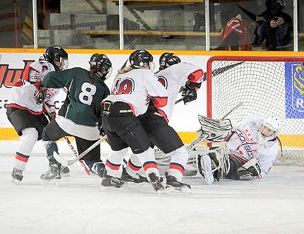 A scramble ensues in front of Central Plains' net during Saskatoon's 5-1 win in the bronze medal game on Saturday at the 2015 Esso Cup in Red Deer, Alta. (Andy Devlin/Hockey Canada Images)