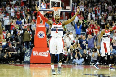 WASHINGTON, DC - APRIL 26: John Wall #2 of the Washington Wizards celebrates during the third quarter of the game against the Toronto Raptors during Game Four of the Eastern Conference Quarterfinals of the NBA playoffs at Verizon Center on April 26, 2015 in Washington, DC. Washington won the game 125-94. Greg Fiume/AFP