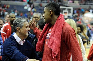 WASHINGTON, DC - APRIL 26: Bradley Beal #3 of the Washington Wizards celebrates with owner Ted Leonsis after a victory against the Toronto Raptors during Game Four of the Eastern Conference Quarterfinals of the NBA playoffs at Verizon Center on April 26, 2015 in Washington, DC. Washington swept the series 4-0. Greg Fiume/AFP