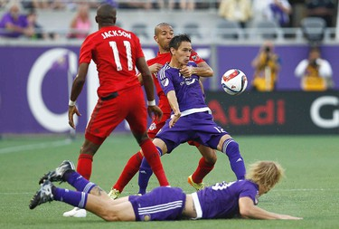 Apr 26, 2015; Orlando, FL, USA; Orlando City FC midfielder Eric Avila (12) and Toronto FC defender Justin Morrow (rear) battle for the ball as Orlando City FC midfielder/defender Brek Shea (bottom) and Toronto FC midfielder Jackson Goncalves (11) look on  during the first half of an MLS soccer match at Orlando Citrus Bowl Stadium. Reinhold Matay-USA TODAY Sports