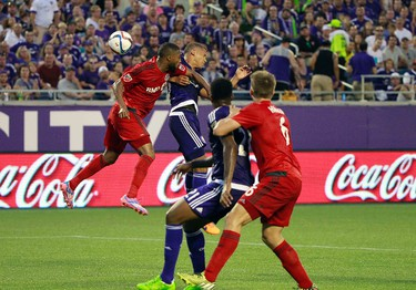 Apr 26, 2015; Orlando, FL, USA; Toronto FC defender Ashtone Morgan (5) and Orlando City SC defender Tyler Turner (2) head theball during the first half at Orlando Citrus Bowl Stadium. Kim Klement-USA TODAY Sports