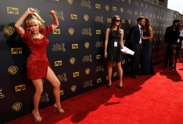 Actress Charo poses as she arrives at the 42nd Annual Daytime Emmy Awards in Burbank, California April 26, 2015,  REUTERS/Patrick T. Fallon