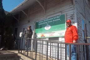 John Arends and Anthony Clark pose outside Wallaceburg railway station on Arnold Street on April 25. The Southern Ontario Locomotive Rail Society—St. Clair chapter is working to try and restore the station.