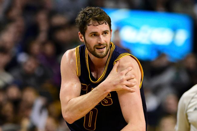 Cleveland Cavaliers forward Kevin Love holds his injurded shoulder during Game 4 of the first round of the NBA playoffs against the Boston Celtics at TD Garden. (Bob DeChiara/USA TODAY Sports)