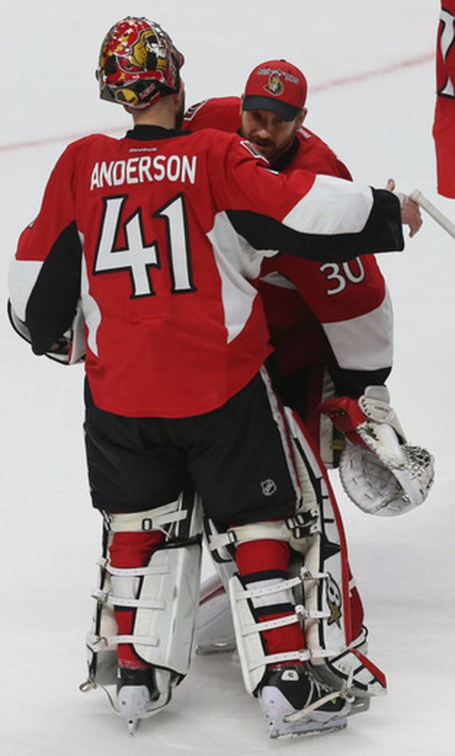 Ottawa Senators goalies Craig Anderson and Andrew Hammond hug after losing to the Montreal Canadiens at the Canadian Tire Centre in Ottawa Sunday, April 26, 2015. (Tony Caldwell/Ottawa Sun)