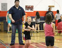 Coun. Ryan Espey helps out during La Verendrye School's Jump Rope For Heart fundraiser on April 20, 2014. The students raised $3,200. (Johnna Ruocco/THE GRAPHIC/POSTMEDIA NETWORK)