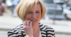 Alberta NDP leader Rachel Notley gestures as she leaves during a campaign stop in southeast Calgary, Alta on Tuesday April 28, 2015. Albertans go to the polls on May 5, 2015. Jim Wells/Calgary Sun/Postmedia Network