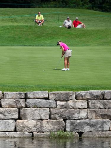 Brooke Henderson of Smiths Falls, Ontario putts on the second hole during Round 1 of the 2014 Canadian Pacific Canadian Women's Open at the London Hunt and Country Club in London, Ontario on Thursday August 21, 2014. CRAIG GLOVER/Postmedia Newtwork/Files