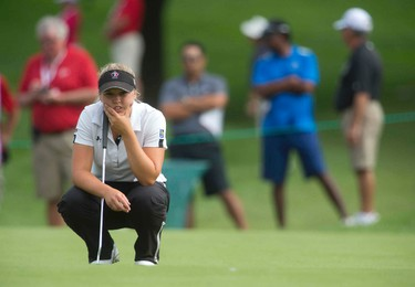 Brooke Henderson of Smiths Falls, Ontario lines up her putt on the fourth green during the final round of the 2014 Canadian Pacific Women's Canadian Open at the London Hunt and Country Club in London, Ontario on Sunday August 24, 2014. CRAIG GLOVER/Postmedia Newtwork/Files