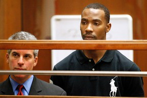Former Los Angeles Lakers guard Javaris Crittenton (R) appears in Los Angeles Superior Court for an extradition hearing with attorney Brian Steel (L) in downtown Los Angeles August 31, 2011. (REUTERS)