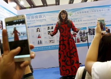 Visitors take pictures of a humanoid robot named Yangyang during its demonstration at the Global Mobile Internet Conference (GMIC) 2015 in Beijing, China, April 29, 2015. REUTERS/Kim Kyung-Hoon