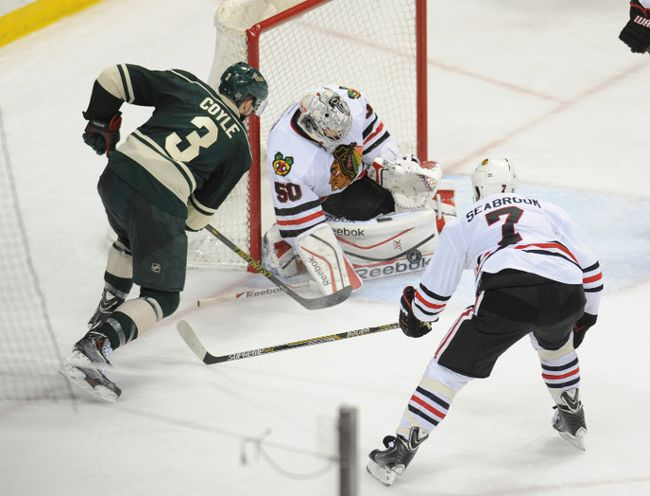 Minnesota Wild winger Charlie Coyle (3) shoots against Chicago Blackhawks goalie Corey Crawford (50) in the 2014 playoffs. (USA Today Sports)