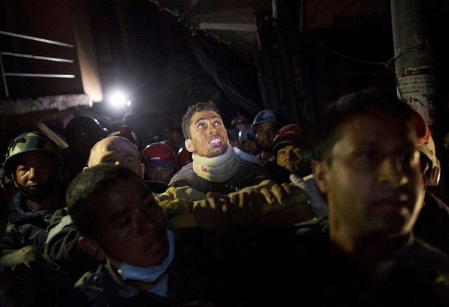 Rishi Khanal, an injured survivor, is carried on a stretcher by Nepali police after being rescued by French rescue teams from a damaged building following Saturday's earthquake in Kathmandu, Nepal, April 28, 2015. (REUTERS/Danish Siddiqui)