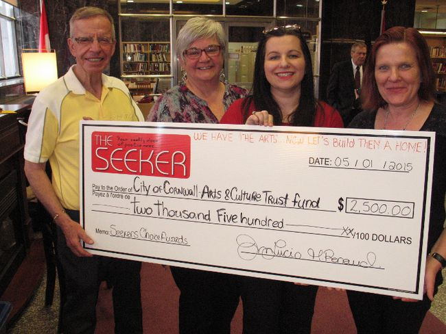 <p>The Seeker media outlet in Cornwall has donated $2,500 to the Centre for the Arts Collective. From left are collective president John McMartin, collective committee chair Rose Desnoyers, and The Seeker's Julia Lucio and Mais-Liis Renaud, on Friday May 1, 2015 in Cornwall, Ont. Todd Hambleton/Cornwall Standard-Freeholder/Postmedia Network