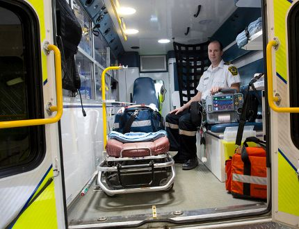 Middlesex-London EMS superintendent of education Jay Loosley sits in the back of an ambulance in their Waterloo Street headquarters in London on Friday. Loosley says the emergency service is seeing an increase in the number of calls for patients who have overdosed.Craig Glover/The London Free Press/Postmedia Network