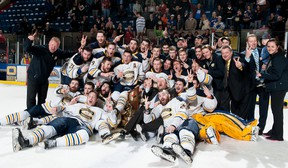 The Carleton Place Canadians celebrate their Fred Page Cup championship, Sunday in Cornwall. The Canadians are the first team to win back-to-back Fred Page Cup titles. Robert Lefebvre/Special to the Cornwall Standard-Freeholder/Postmedia Network