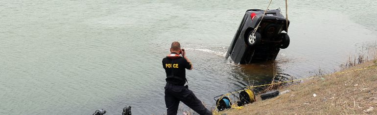 The van involved in the fatal crash into Little Pearl Lake on Friday was recovered from the lake Sunday afternoon by OPP marine recovery divers.  Timmins Times LOCAL NEWS photo by Len Gillis.