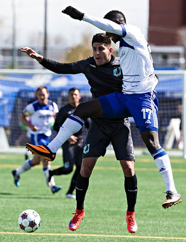 Edmonton's Lance Laing and Minnesota's Kevin Venegas try to control the ball during FC Edmonton's NASL soccer game against Minnesota United FC at Clarke Field in Edmonton, Alta. on Sunday, May 3, 2015. Codie McLachlan/Edmonton Sun/Postmedia Network