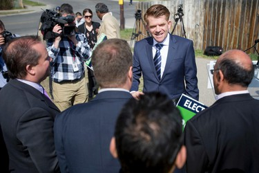 Wildrose leader Brian Jean chats with supporters during a campaign stop in Calgary, Alta., on Friday, May 1, 2015. Jean was on the final days of his Wildrose election campaign, leading up to the May 5 provincial vote. Lyle Aspinall/Calgary Sun/Postmedia Network