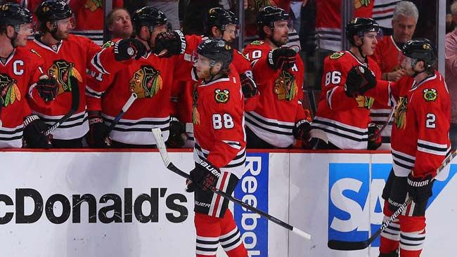 Blackhawks right wing Patrick Kane (88) is congratulated for scoring during the second period in game two of the second round of the 2015 Stanley Cup Playoffs against the Wild in Chicago, Sunday, May 3, 2015. Dennis Wierzbicki-USA TODAY Sports