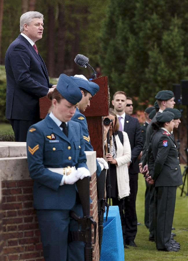 Prime Minister Stephen Harper, left, speaks during the Government of Canada ceremony of remembrance in the Canadian war cemetery at Holten, in the Netherlands, May 4, 2015. REUTERS/Michael Kooren