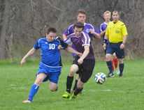 Jake Fitzgerald of the Simcoe Sabres battles for the ball with Devin Brown of the Valley Heights Bears during a boys soccer game Monday at Valley Heights Secondary School. The Sabres beat the Bears 3-0. (EDDIE CHAU Simcoe Reformer)