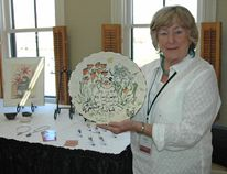 Paulette Robertson with one of her clay creations Saturday at the Station Arts Centre in Tillsonburg during the 8th Annual Oxford Studio Tour. (CHRIS ABBOTT/TILLSONBURG NEWS)