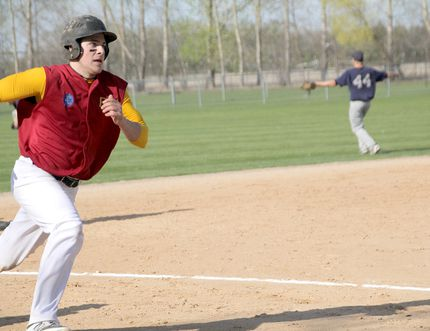 PCI Trojans' Tanner Blight rounds third and scores a run during an 8-5 win over the Mennonite Collegiate Blues on May 4 at Republic Park. PCI won both games in its doubleheader against MCI, taking the second 11-0. (Matt Hermiz/TheGraphic/Postmedia Network)