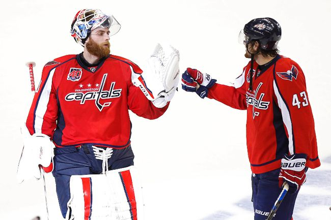 Washington Capitals goalie Braden Holtby (left) and winger Tom Wilson celebrate after their win over the New York Rangers in Game 2 of their second-round playoff series Monday at the Verizon Center. (Geoff Burke/USA TODAY Sports)