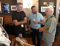 Jared Smith (left) and Jason Puhr talk art with photographer Earle Barr (right) during the Oxford Studio Tour Saturday at the Station Arts Centre. (CHRIS ABBOTT/TILLSONBURG NEWS)