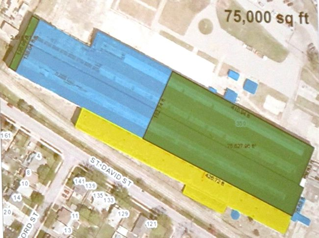 A colour-coded aerial image of the former locomotive repair shops at the Cooper site in Stratford illustrates a proposal to demolish a portion of the building at the west end (in blue) while retaining about 75,000 square feet of space (in green).