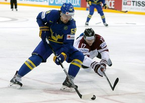 Anton Lander's linemates at the world championship in Prague, Filip Forsberg and Loui Eriksson, each have hat-tricks at the event. (David W. Cerny, Reuters)