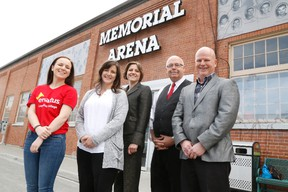 JASON MILLER/THE INTELLIGENCER Olivia Millard (first from left), president of Enactus Loyalist, Tanya Baldwin, project lead for the Memorial Regional Collective,  David Somers, the collective's co-chair, Luisa Sorrentino and Bob Millard, stand outside the Memorial Arena, one of the city-owned buildings they want to transform into a cultural centre.